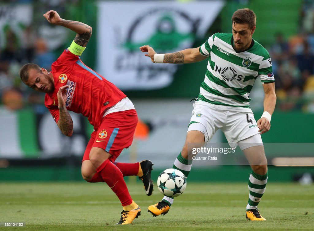 Sporting CP defender Sebastian Coates from Uruguay (R) with Steaua Bucuresti FC forward Denis Alibec from Romania (L) in action during the UEFA Champions League Qualifying Play-Offs Round - First Leg match between Sporting Clube de Portugal and Steaua Bucuresti FC at Estadio Jose Alvalade on August 15, 2017 in Lisbon, Portugal.