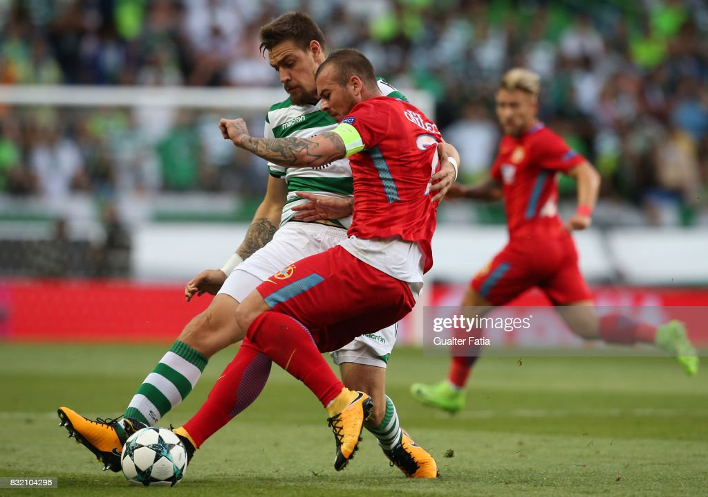 Sporting CP defender Sebastian Coates from Uruguay with Steaua Bucuresti FC forward Denis Alibec from Romania in action during the UEFA Champions League Qualifying Play-Offs Round - First Leg match between Sporting Clube de Portugal and Steaua Bucuresti FC at Estadio Jose Alvalade on August 15, 2017 in Lisbon, Portugal.