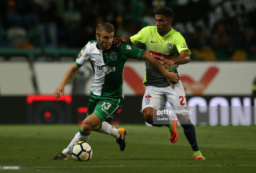 Sporting CP defender Stefan Ristovski from Macedonia with CS Maritimo defender Bebeto from Brazil in action during the Portuguese League Cup match between Sporting CP and CS Maritimo at Estadio Jose Alvalade on September 19, 2017 in Lisbon, Portugal.