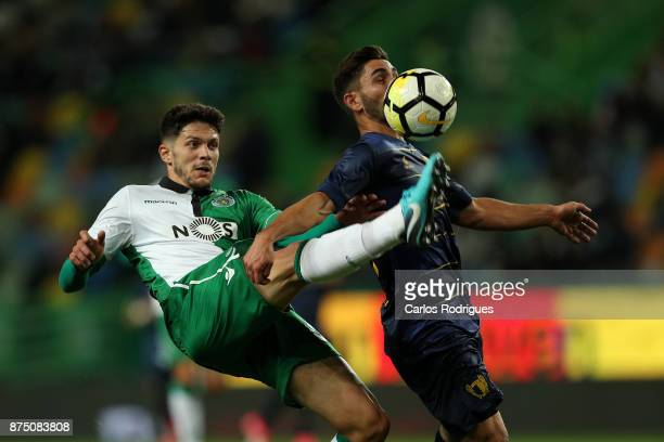 Sporting CP defender Tobias Figueiredo from Portugal vies with Famalicao midfielder Rui Costa from Portugal during the match between Sporting CP and...
