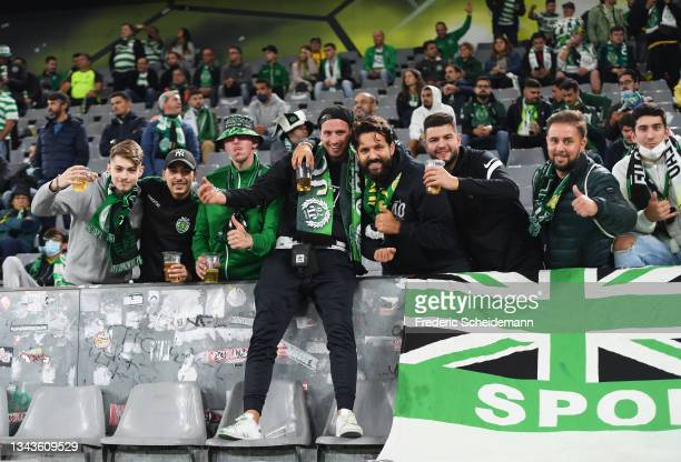 Sporting CP fans pose for a photograph inside the stadium prior to the UEFA Champions League group C match between Borussia Dortmund and Sporting CP...