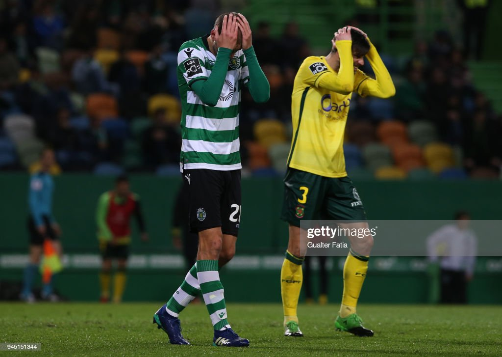 Sporting CP forward Bas Dost from Holland and FC Pacos de Ferreira defender Rui Correia from Portugal react during the Primeira Liga match between Sporting CP and FC Pacos de Ferreira at Estadio Jose Alvalade on April 8, 2018 in Lisbon, Portugal.