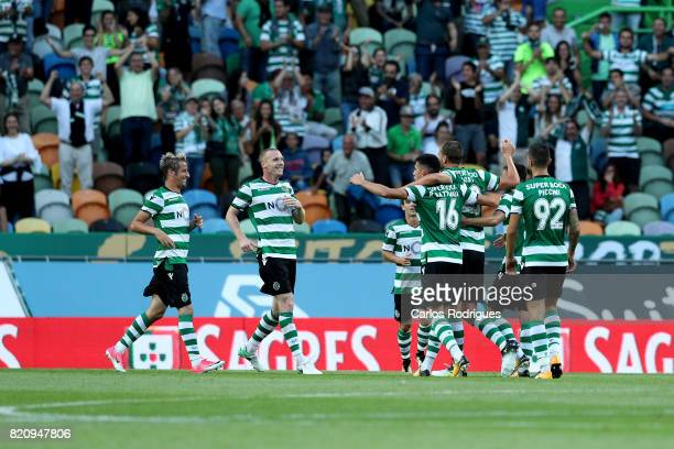 Sporting CP forward Bas Dost from Holland celebrates scoring Sporting second goal with his team mates during the Friendly match between Sporting CP...