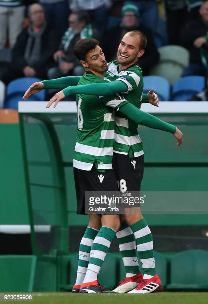 Sporting CP forward Bas Dost from Holland celebrates with teammate Sporting CP defender Andre Pinto from Portugal after scoring a goal during the...