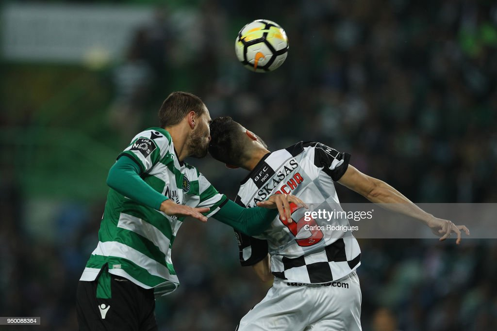 Sporting CP forward Bas Dost from Holland (L) vies with Boavista FC defender Talocha from Portugal (R) for the ball possession during the Portuguese Primeira Liga match between Sporting CP and Boavista FC at Estadio Jose Alvalade on April 22, 2018 in Lisbon, Lisboa.