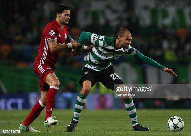 Sporting CP forward Bas Dost from Holland with Olympiakos Piraeus defender Alberto Botia from Spain in action during the UEFA Champions League match...