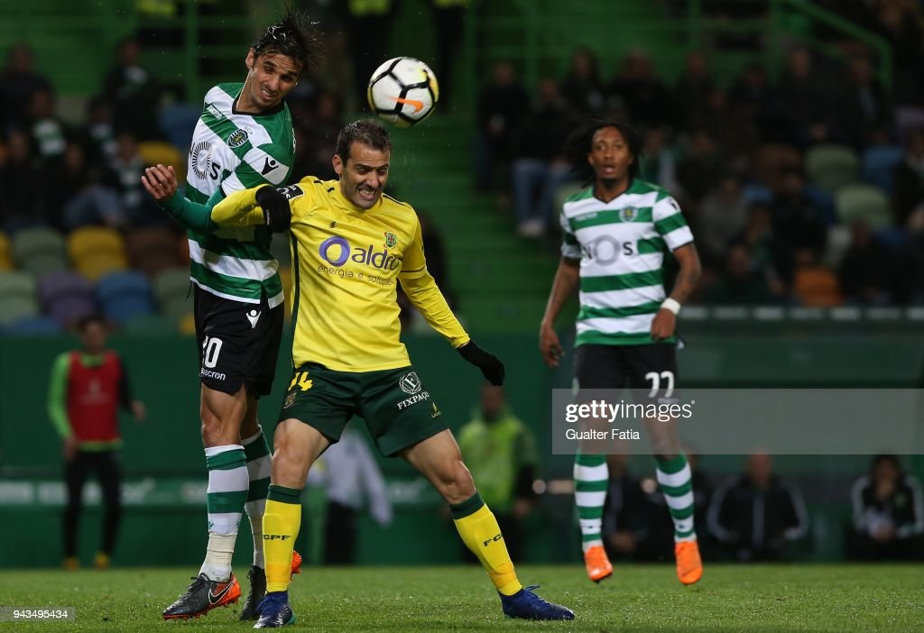 Sporting CP forward Bryan Ruiz from Costa Rica with FC Pacos de Ferreira midfielder Ruben Micael from Portugal in action during the Primeira Liga match between Sporting CP and FC Pacos de Ferreira at Estadio Jose Alvalade on April 8, 2018 in Lisbon, Portugal.