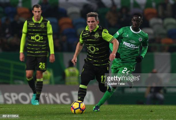 Sporting CP forward Daniel Pondence from Portugal with Vilaverdense FC midfielder Latyr Fall in action during the Portuguese Cup match between...
