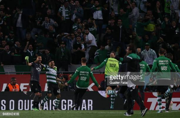 Sporting CP forward Fredy Montero from Colombia celebrates with teammate Sporting CP goalkeeper Rui Patricio from Portugal after scoring the winning...