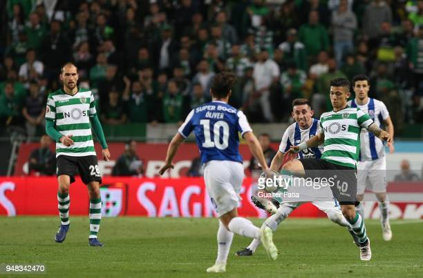 Sporting CP forward Fredy Montero from Colombia with FC Porto midfielder Hector Herrera from Mexico in action during the Portuguese Cup match between...