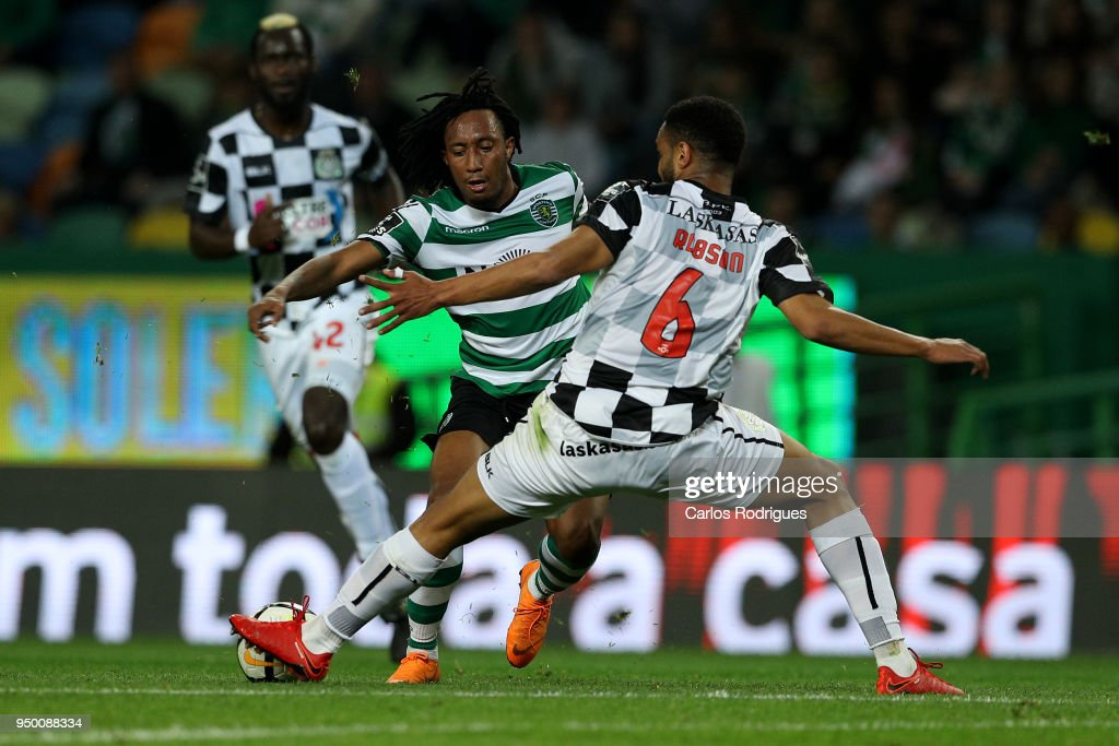 Sporting CP forward Gelson Martins from Portugal (L) tries to escape Boavista FC defender Robson from Brazil (R) during the Portuguese Primeira Liga match between Sporting CP and Boavista FC at Estadio Jose Alvalade on April 22, 2018 in Lisbon, Lisboa.