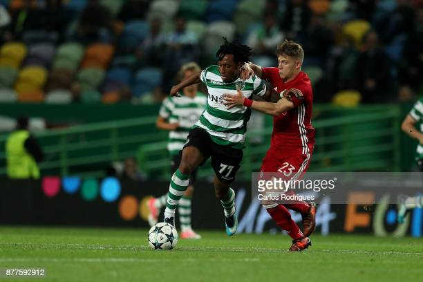 Sporting CP forward Gelson Martins from Portugal vies with Olympiakos Piraeus defender Leonardo Koutris from Greece for the ball possession during...
