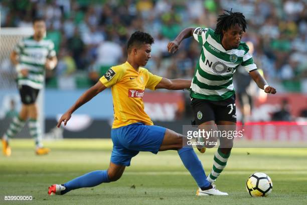 Sporting CP forward Gelson Martins from Portugal with GD Estoril Praia forward Gustavo Tocantins from Brazil in action during the Primeira Liga match...