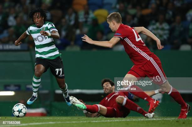 Sporting CP forward Gelson Martins from Portugal with Olympiakos Piraeus defender Alberto Botia from Spain in action during the UEFA Champions League...