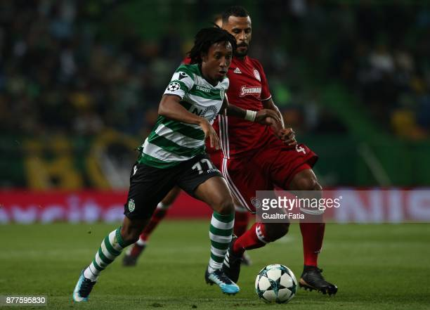 Sporting CP forward Gelson Martins from Portugal with Olympiakos Piraeus midfielder Alaixys Romao from Tongo in action during the UEFA Champions...