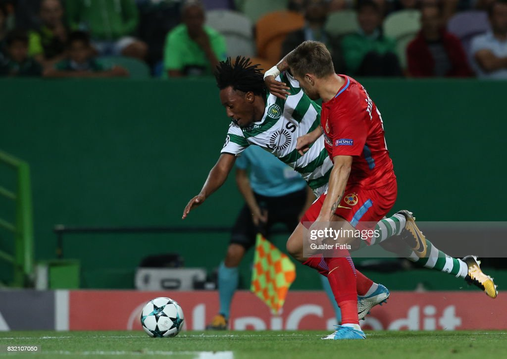 Sporting CP forward Gelson Martins from Portugal with Steaua Bucuresti FC midfielder Mihai Pintilii from Romania in action during the UEFA Champions League Qualifying Play-Offs Round - First Leg match between Sporting Clube de Portugal and Steaua Bucuresti FC at Estadio Jose Alvalade on August 15, 2017 in Lisbon, Portugal.