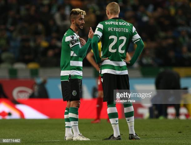 Sporting CP forward Ruben Ribeiro from Portugal talks to Sporting CP defender Jeremy Mathieu from France during the Primeira Liga match between...