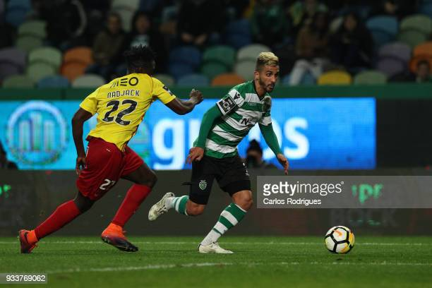 Sporting CP forward Ruben Ribeiro from Portugal tries to escape Rio Ave FC defender Eliseu Nadjack from Portugal during the Portuguese Primeira Liga...