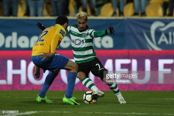 Sporting CP forward Ruben Ribeiro from Portugal tries to pass trough GD Estoril Praia defender Rafik Halliche from Algeria during the match between...