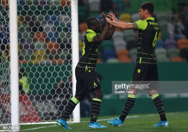 Sporting CP forward Seydou Doumbia from Ivory Coast celebrates with teammate Sporting CP defender Andre Pinto from Portugal after scoring a goal...
