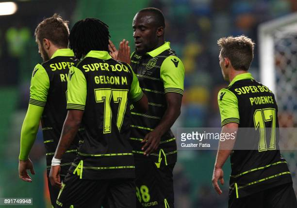 Sporting CP forward Seydou Doumbia from Ivory Coast celebrates with teammates after scoring a goal during the Portuguese Cup match between Sporting...