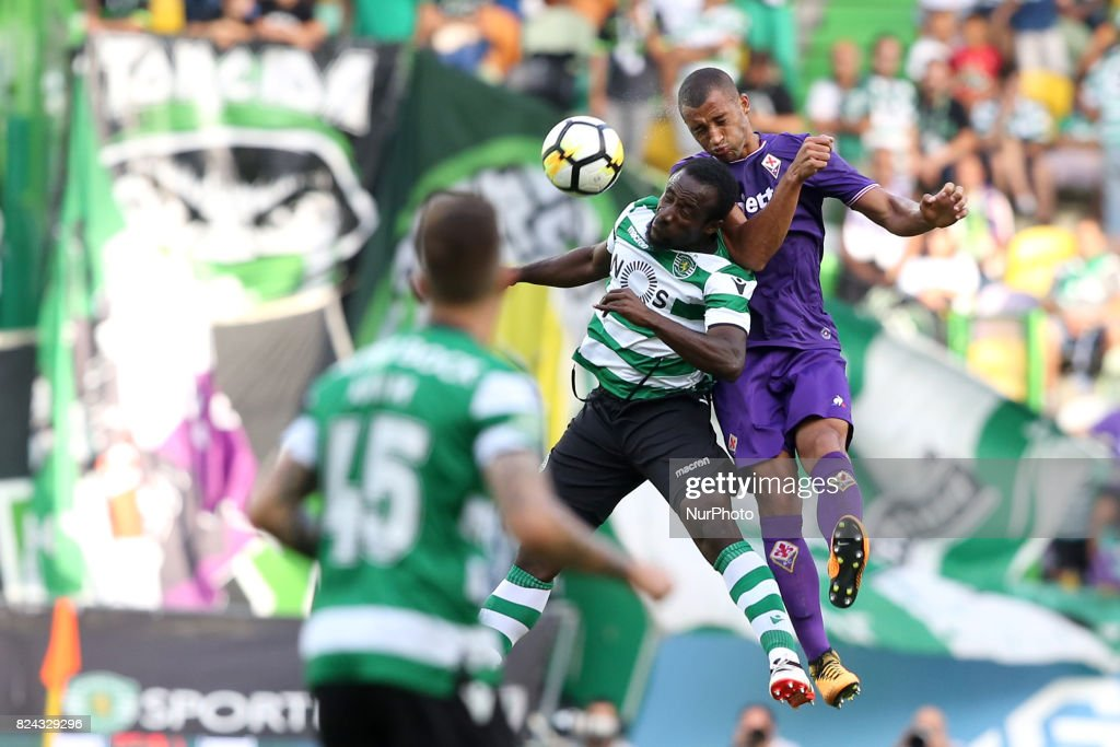 Sporting CP forward Seydou Doumbia from Ivory Coast (c ) heads the ball with Fiorentina defender Bruno Gaspar from Portugal (R ) during the Trophy Five Violins 2017 final football match Sporting CP vs ACF Fiorentina at Alvadade stadium in Lisbon, Portugal on July 29, 2017.