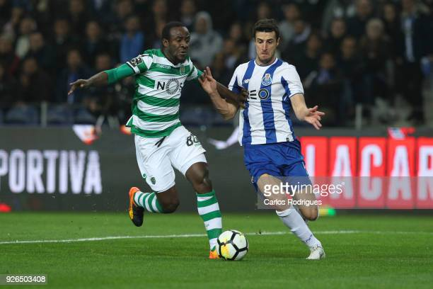 Sporting CP forward Seydou Doumbia from Ivory Coast vies with FC Porto defender Diogo Dalot from Portugal for the ball possession during the...