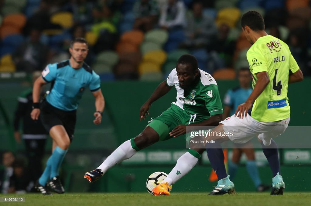 Sporting CP forward Seydou Doumbia from Ivory Coast with CS Maritimo defender Pablo Santos from Brazil in action during the Portuguese League Cup match between Sporting CP and CS Maritimo at Estadio Jose Alvalade on September 19, 2017 in Lisbon, Portugal.
