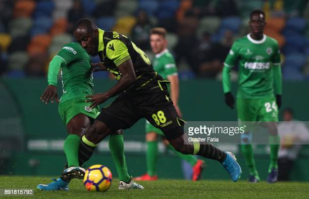 Sporting CP forward Seydou Doumbia from Ivory Coast with Vilaverdense FC midfielder Ibraima So in action during the Portuguese Cup match between...