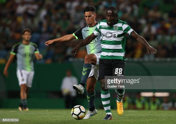 Sporting CP forward Seydou Doumbia from Ivory Coast with Vitoria Setubal midfielder Andre Pedrosa from Portugal in action during the Primeira Liga...