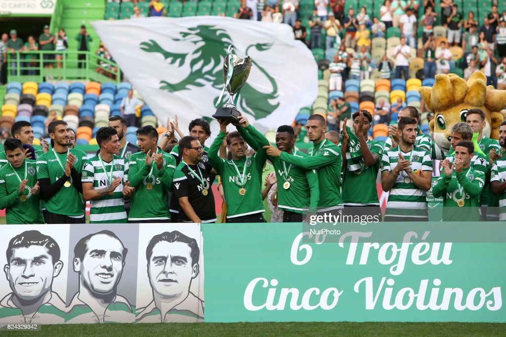 Sporting CP midfielder Adrien Silva from Portugal raises the trophy after the Trophy Five Violins 2017 final football match Sporting CP vs ACF Fiorentina at Alvadade stadium in Lisbon, Portugal on July 29, 2017. Sporting won 1-0.
