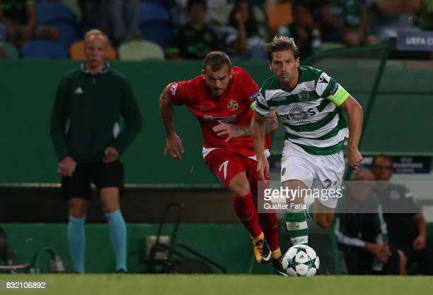 Sporting CP midfielder Adrien Silva from Portugal with Steaua Bucuresti FC forward Denis Alibec from Romania in action during the UEFA Champions...