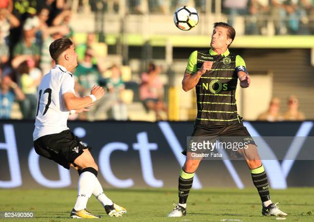 Sporting CP midfielder Adrien Silva from Portugal with Vitoria Guimaraes forward Helder Ferreira from Portugal in action during PreSeason Friendly...
