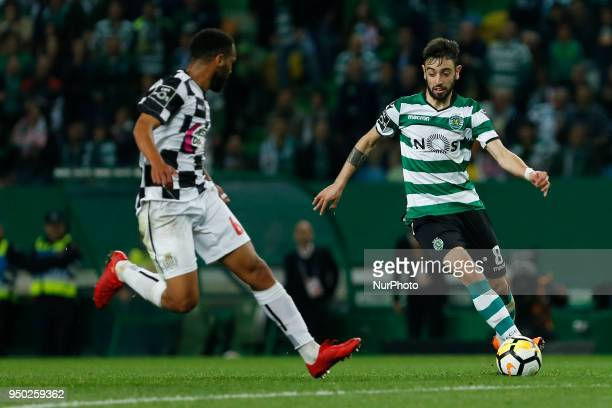 Sporting CP Midfielder Bruno Fernandes from Portugal and Boavista FC Defender Robson from Brazil during the Premier League 2017/18 match between...