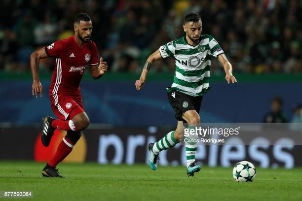 Sporting CP midfielder Bruno Fernandes from Portugal tries to escape Olympiakos Piraeus midfielder Alaixys Romao from Tongo during the UEFA Champions...