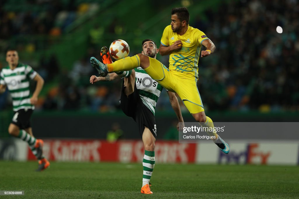 Sporting CP midfielder Bruno Fernandes from Portugal (L) vies with Astana midfielder Marko Stanojevic from Serbia (R) for the ball possession during UEFA Europa League Round of 32 match between Sporting Lisbon and FC Astana at the Estadio Jose Alvalade on February 22, 2018 in Lisbon, Portugal.