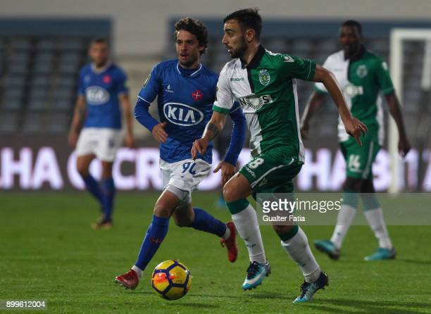 Sporting CP midfielder Bruno Fernandes from Portugal with CF Os Belenenses midfielder Filipe Chaby from Portugal in action during the Portuguese...