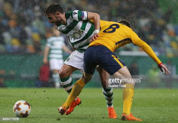 Sporting CP midfielder Bruno Fernandes from Portugal with Club Atletico de Madrid midfielder Saul Niguez from Spain in action during the UEFA Europa...