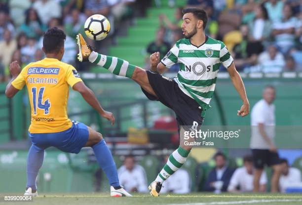 Sporting CP midfielder Bruno Fernandes from Portugal with GD Estoril Praia forward Gustavo Tocantins from Brazil in action during the Primeira Liga...