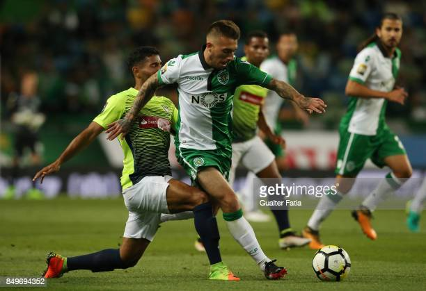 Sporting CP midfielder Iuri Medeiros from Portugal with CS Maritimo defender Bebeto from Brazil in action during the Portuguese League Cup match...