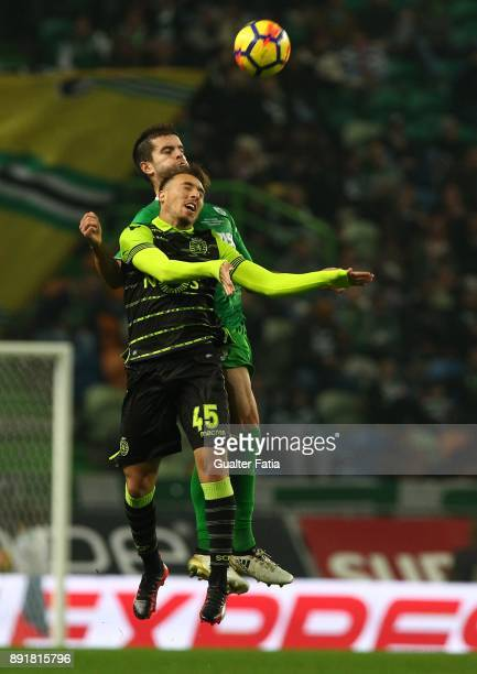 Sporting CP midfielder Iuri Medeiros from Portugal with Vilaverdense FC forward Jose Pedro in action during the Portuguese Cup match between Sporting...