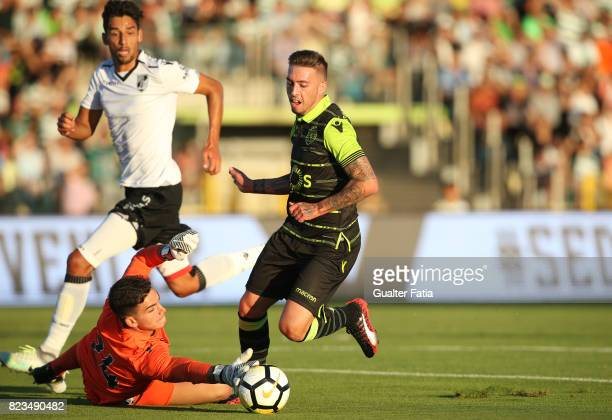 Sporting CP midfielder Iuri Medeiros from Portugal with Vitoria Guimaraes goalkeeper Miguel Oliveira from Portugal and Vitoria Guimaraes defender...