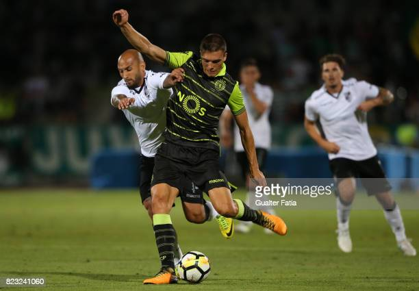 Sporting CP midfielder Joao Palhinha from Portugal with Vitoria Guimaraes forward Rafael Martins from Brazil in action during PreSeason Friendly...