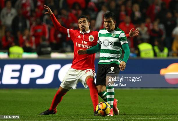 Sporting CP midfielder Marcos Acuna from Argentina with SL Benfica defender Andre Almeida from Portugal in action during the Primeira Liga match...