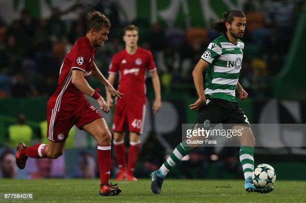 Sporting CP midfielder Matheus Oliveira from Brazil with Olympiakos Piraeus midfielder Guilaume Gillet from Belgium in action during the UEFA...