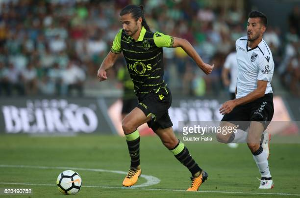 Sporting CP midfielder Matheus Oliveira from Brazil with Vitoria Guimaraes defender Joao Aurelio from Portugal in action during PreSeason Friendly...