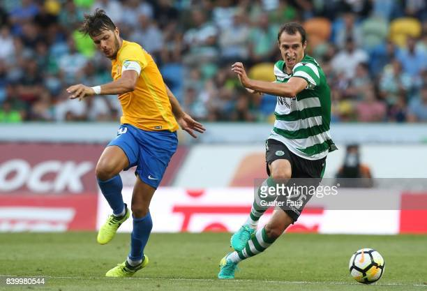 Sporting CP midfielder Radosav Petrovic from Serbia with GD Estoril Praia forward Kleber from Brazil in action during the Primeira Liga match between...
