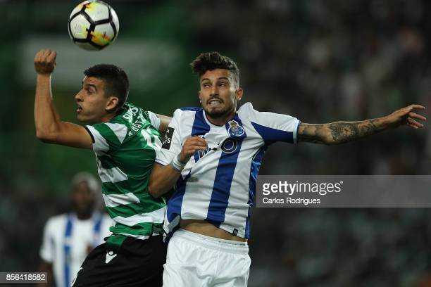 Sporting CP midfielder Rodrigo Battaglia from Argentina vies with FC Porto's defender Alex Telles from Brazil for the ball possession during the...