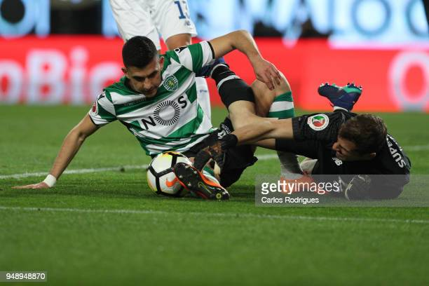 Sporting CP midfielder Rodrigo Battaglia from Argentina vies with FC Porto goalkeeper Iker Casillas from Spain for the ball possession during the...