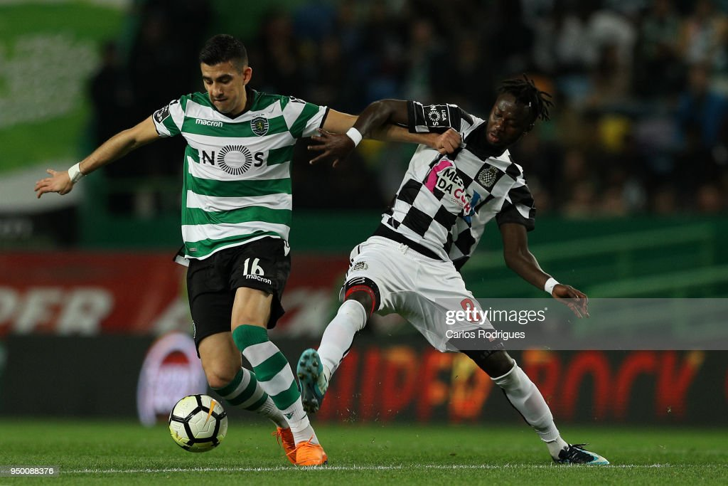 Sporting CP midfielder Rodrigo Battaglia from Argentina (L) vies with Boavista FC forward Yusupha Njie from Gambia (R) for the ball possession during the Portuguese Primeira Liga match between Sporting CP and Boavista FC at Estadio Jose Alvalade on April 22, 2018 in Lisbon, Lisboa.